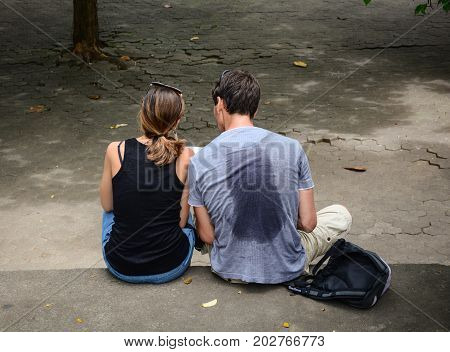 A Couple Sitting At The Park In Bali, Indonesia