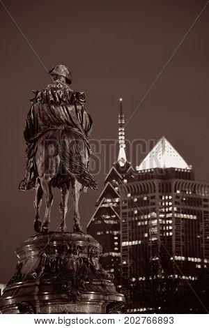 George Washington statue and Philadelphia city architecture at night