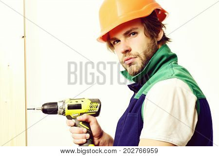 Work In Progress And Repairing Concept. Construction Worker Holds Drill