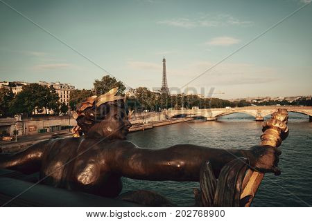 Statue on Alexandre III bridge and River Seine in Paris, France.
