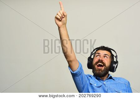 Guy With Beard And Excited Face Listens To Music