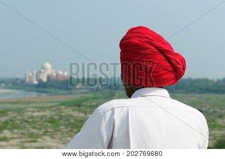 Indian people looking on the white marble Taj Mahal in India Agra Uttar Pradesh