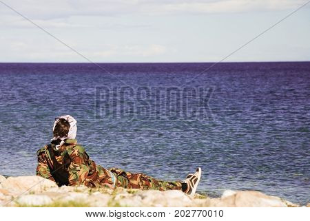 Man lies on the beach and looks at the sea