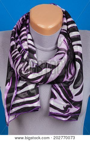 Lilac Scarf On Mannequin Isolated On Blue Background