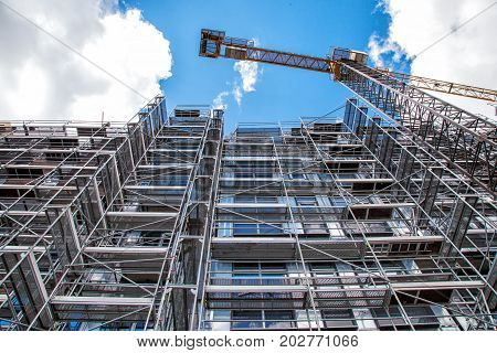 construction of a new multi-storey building in the city on summer day