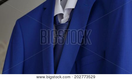 Businessman and suit jacket. suit jacket hangs on the hanger in the room.