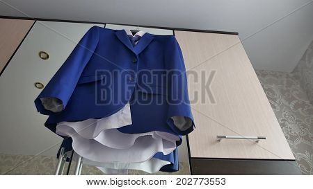 Businessman and suit jacket. suit jacket hangs on the hanger in room.
