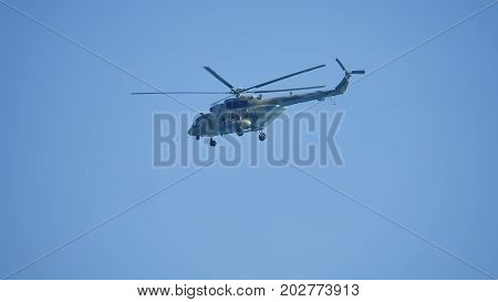 Helicopter flying, blue sky and white clouds