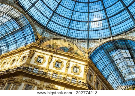 Milan, Italy - May 16, 2017: Glass doom of the Galleria Vittorio Emanuele II in central Milan. This gallery is one of the world's oldest shopping malls and tourist attraction of Milan.