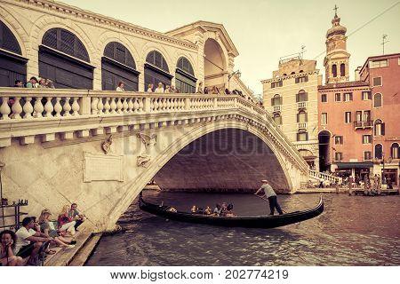 Venice, Italy - May 17, 2017: Rialto Bridge over the Grand Canal. Rialto Bridge (Ponte di Rialto) is one of the main tourist attractions of Venice.