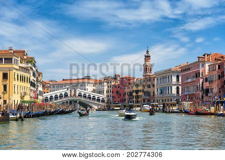 Venice, Italy - May 18, 2017: Boats with tourists are sailing along the Grand Canal from the Rialto Bridge. Grand Canal is one of the major water-traffic corridors and tourist attraction in Venice.