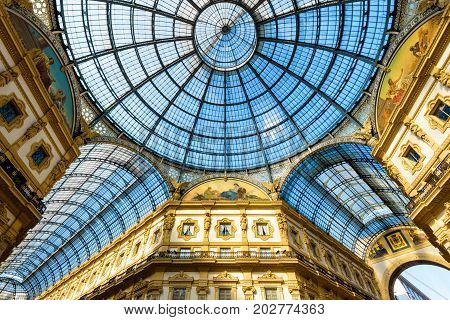 Milan, Italy - May 16, 2017: Glass doom of Galleria Vittorio Emanuele II in central Milan. This gallery is one of the world's oldest shopping malls and tourist attraction of Milan.