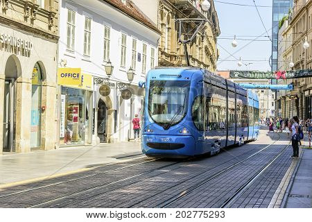 ZAGREB, CROATIA - JULY 17, 2017: Square Ban Josip Jelacic with tourists and trams on a summer day in Zagreb. City of Zagreb is the capital of Croatia.