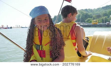 Happy family is swimming on catamaran on the sea to the ocean. family holiday