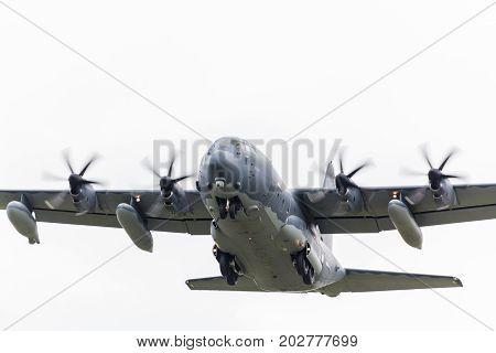 Mc-130J Commando Ii Hercules Raises Its Landing Gear