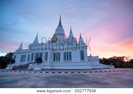 Twilight sunset white Pagoda faith of Buddhism Wat this is a public of Thai people or Buddhism in Thailand.