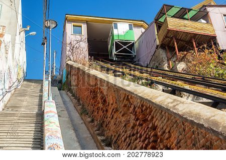 Stairs and a funicular railway going up a hill in Valparaiso Chile