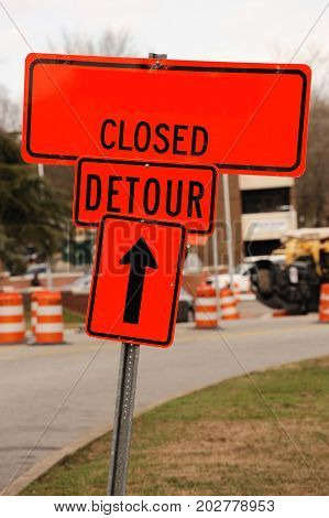 road closed and detour traffic sign in the street
