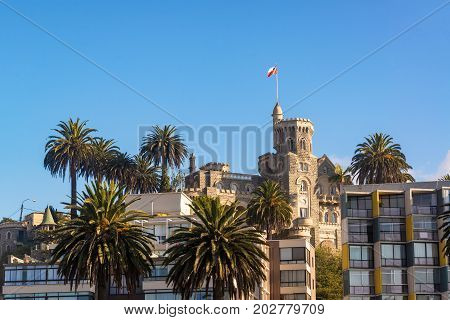 View of Brunet Castle and palm trees in Vina del Mar Chile