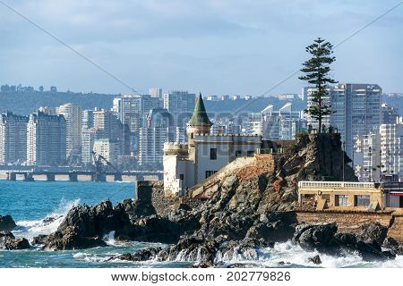View of Wulff Castle with apartment buildings in the background in Vina del Mar Chile