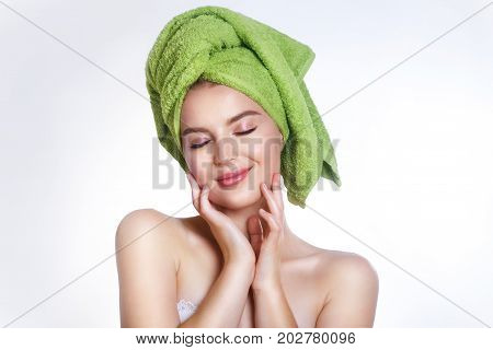 close-up of beautiful young woman with green bath towel .Spa concept