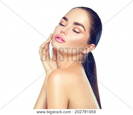 Beautiful Spa Brunette Woman Touching her Face. Perfect Fresh Skin. Beauty Portrait. Pure Beauty Model Girl. Youth and Skin Care Concept. Isolated on white background