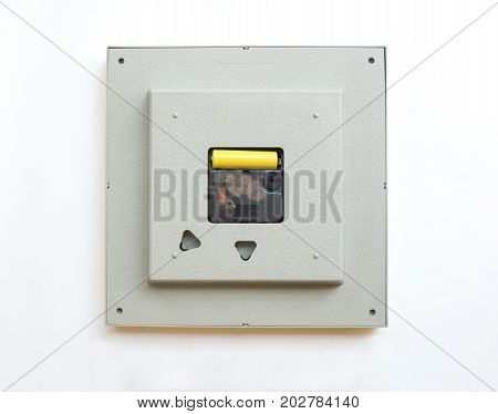 Behind of square clock with gear. Part of machine processor. Isolated on white background and clipping path.