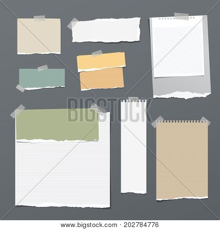White and colorful striped note paper, copybook, notebook sheet stuck with adhesive tape on dark gray background