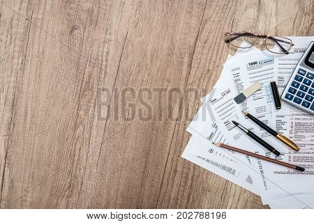 Tax Form With Notepad, Pen, Pencil And Calculator