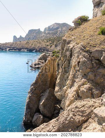 Sheer rocky coast. Travel along the coast along the path of Prince Golitsyn.