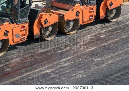 Several Heavy Vibration Rollers At Asphalt Pavement Works. Road Repairing