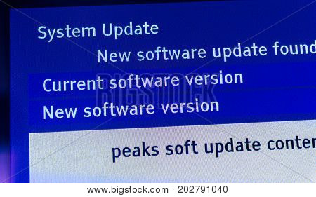 New system software update found - message on modern TV set digital monitor display.