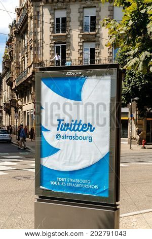 STRASBOURG FRANCE - JUL 29 2017: City public account on twitter - advertising in city of Strasbourg with the message Finds us on Twitter @strasbourg