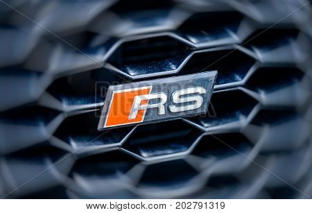 PARIS FRANCE - APR 8 2016: Audi RS logotype seen on the front grille of a powerful Audi sport car