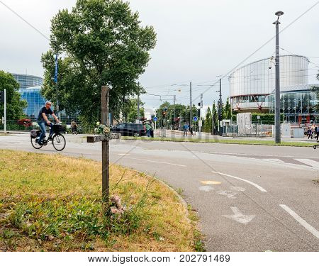 STRASBOURG FRANCE - JUN 30 2017: European Court of Human Rights with wooden cross on the place of dead applicant for a fair process