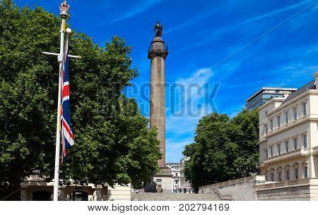 The Duke of York Column in London next to Union Jack, Great Britain flag, United Kingdom.