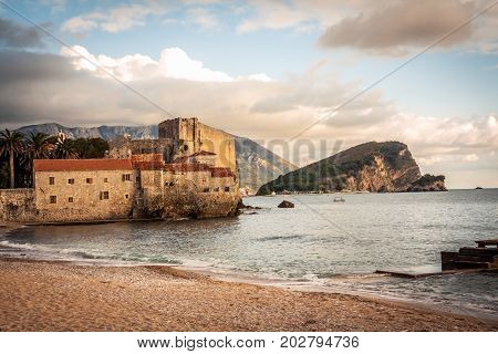 Old European sea fort with medieval architecture at sunset beach in Europe country Montenegro of Balkan peninsula