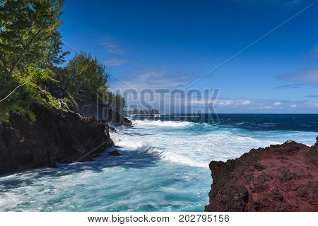 Waves And Volcanic Rocks In The South Coast Of Reunion Island