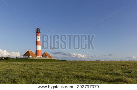 Colorful lighthouse at Westerhever, Schleswig-Holstein, nothern Germany