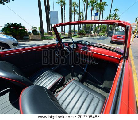 Beautiful red cabriolet, wide angle view. Fashion car in Cannes, France.