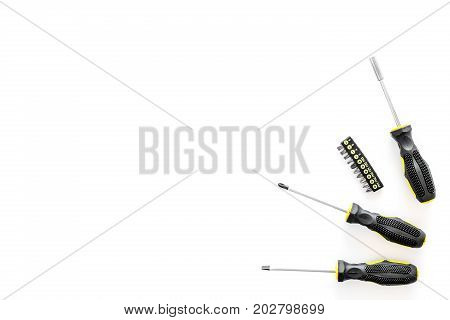 constructor desk with set of building implements with screwdriver on white desk background top view mock up