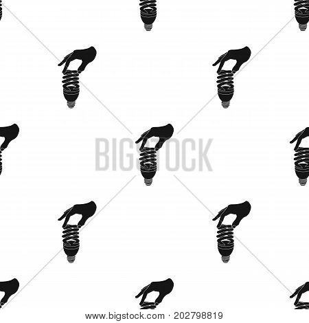 Fluorescent, saving light bulb in hand. Electric lamp single icon in black style vector symbol stock illustration .