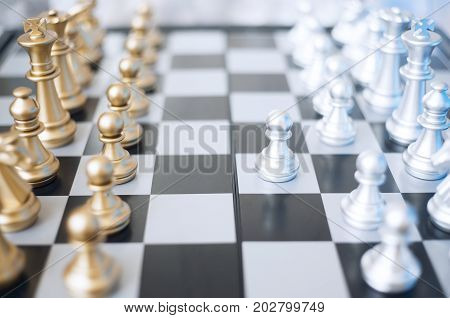 A photo of chess pieces on a chessboard. Business or political concept.
