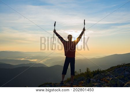 Happy Traveler, With Open Arms, Stands On The Edge Of The Cliff