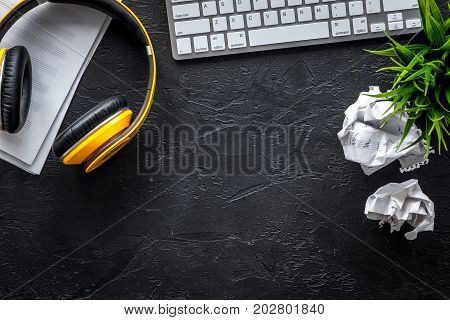 dj work set with blank paper for notes, headphones on dark table background top view space for text