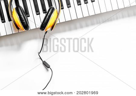 musician work set with synthesizer and headphones on white table background top view space for text