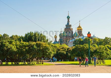 SAINT PETERSBURG RUSSIA - AUGUST 15 2017.The Field of Mars - large park in center of Saint Petersburg and Cathedral of Our Savior on Spilled Blood in Saint Petersburg Russia