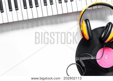 musician work set with synthesizer, record and headphones on white table background top view space for text