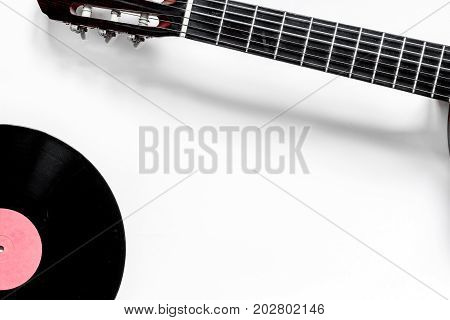guitar with vinyl record in music studio for dj or musician work on white desk background top view mock-up