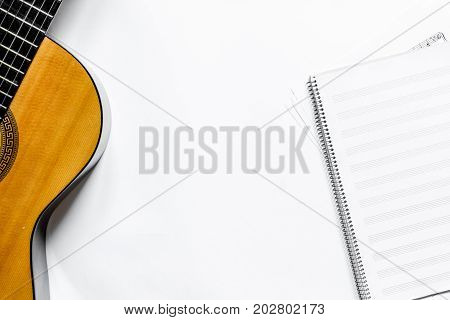 songwriter or dj work place with guitar and notebook on white desk background top view mockup